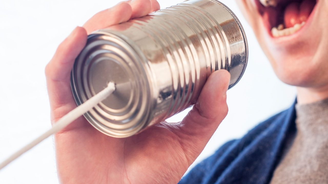 person talking into empty can